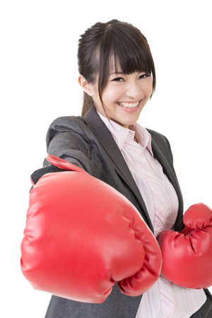Young attractive asian business woman with red boxing gloves are ready for battle. Close-up portrait. Isolated on the white background. photo