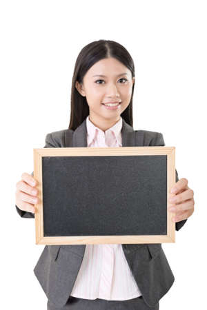 Young asian smiling business woman holding blank blackboard, chalkboard. Close-up portrait. Isolated on the white background. photo
