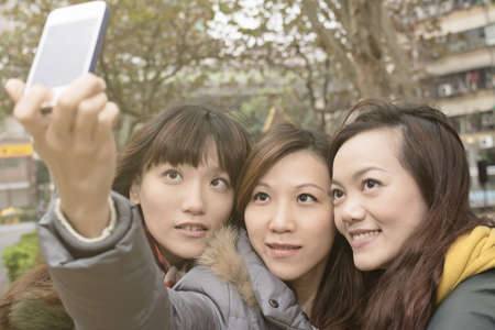 Asian women take picture by themselves. photo