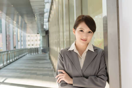 Portrait of attractive Asian business woman at modern building in Taipei, Taiwan Stock Photo