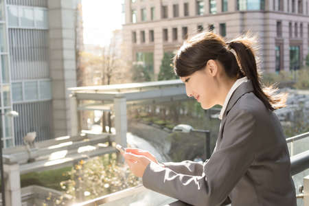Young business woman use cellphone, closeup portrait. Stock Photo - 25557506
