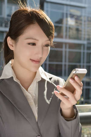 Young business woman use cellphone, closeup portrait. photo