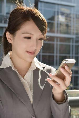 Young business woman use cellphone, closeup portrait. photo