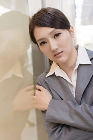 uneasiness: Asian business woman thinking and feel sorrow, closeup portrait.