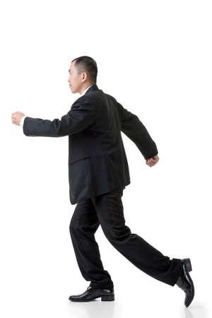 Asian business man running, full length isolated on white. photo