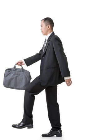 business briefcase: Action of Asian businessman walking on stairs, full length portrait isolated white background. Stock Photo