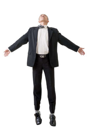 flying man: Asian business man flying isolated on white background. Stock Photo