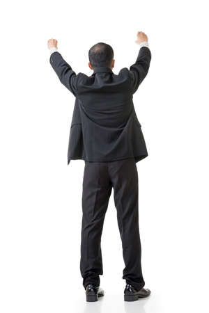 put: Rear view of Asian business man raising hand to put something over his head, full length isolated on white.