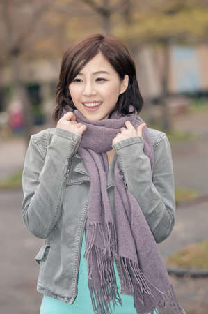 Asian young woman portrait at outdoor in city. photo