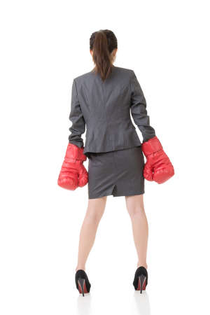 Rear view of Asian business woman with boxing gloves, full length portrait isolated on white. photo