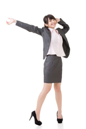 Cheerful Asian businesswoman open arms and feel free, full length portrait isolated on white background. photo