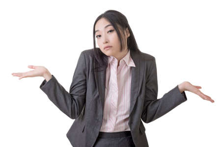 shrugs: Helpless young business woman shrugs her shoulders on white background.