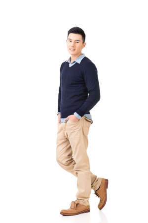 Handsome young Asian man, full length portrait isolated on white background. Фото со стока