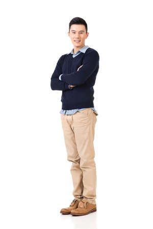 Handsome young Asian man, full length portrait isolated on white background. Stock Photo