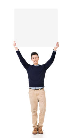 korean man: Handsome young Asian man holding a blank board, full length portrait isolated on white background.