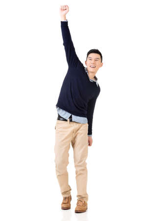 Excited Asian young man, full length portrait. Imagens