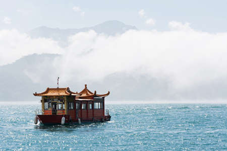 Boat over water at famous attraction, the Sun Moon Lake at Taiwan. photo