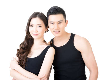 Young Asian sport couple, closeup portrait on white background.