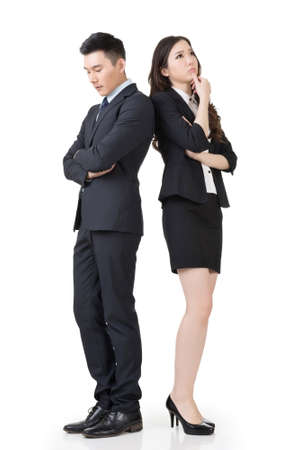 business concern: Asian business man and woman feel confused and worried, full length portrait isolated on white background.