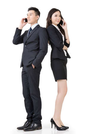 Asian business man and woman take a call, full length portrait isolated on white background. photo