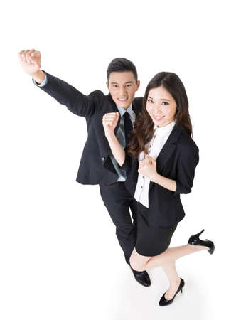 excitation: Cheerful business man and woman, full length portrait. Stock Photo