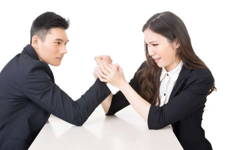 Arm wrestling challenge between a young business man and woman, closeup portrait on white background. photo
