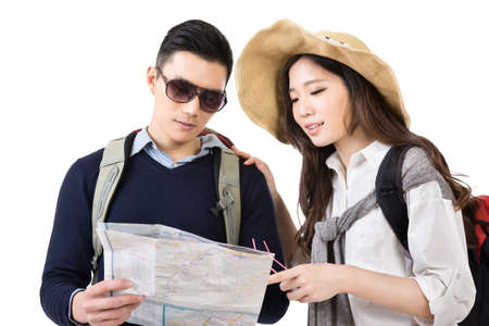 Young Asian couple travelers looking the map, closeup portrait on white background. photo