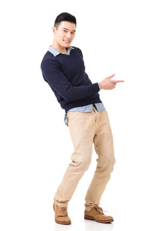 Excited Asian young man, full length portrait. Stock Photo
