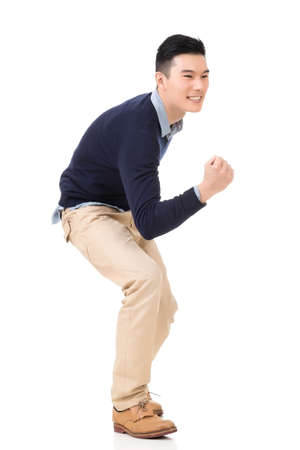 excite: Excited Asian young man, full length portrait. Stock Photo