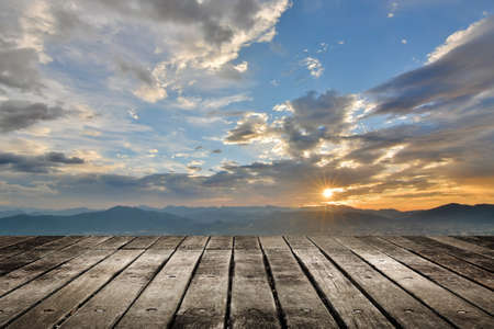 City sunset with wooden ground. photo
