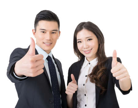 business hands: Smiling asian business man and woman gives you thumbs up gesture. Closeup portrait. Isolated on the white background.  Stock Photo