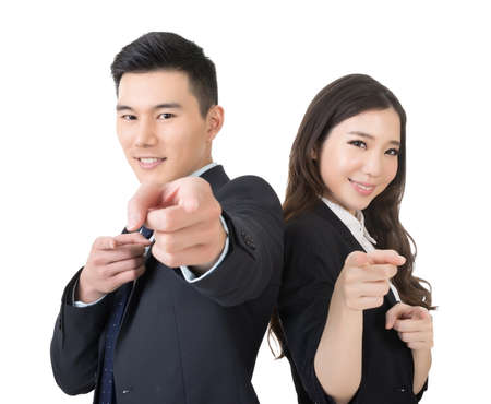 Smiling Asian business man and woman point at you, closeup portrait on white background. photo