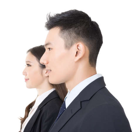 Side view of young business man and woman, closeup portrait. photo