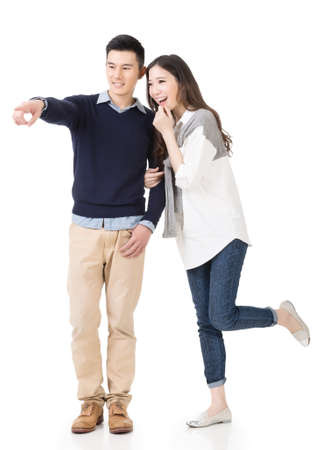 Young attractive Asian couple, full length portrait isolated on white.