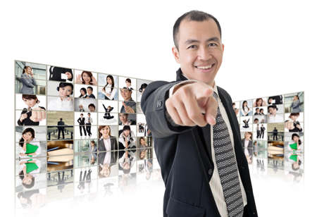 Asian business man or boss standing in front of TV screen wall showing pictures of business concept. Stock Photo - 26654689