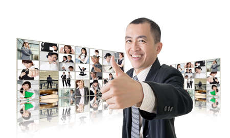 asian business team: Asian business man or boss standing in front of TV screen wall showing pictures of business concept.