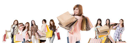 Happy Asian shopping girls on white background  Stock Photo