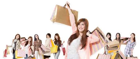 Happy Asian shopping girls on white background  photo