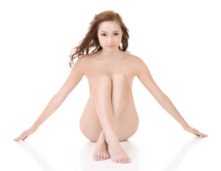 Sexy nude Asian woman sit on studio white ground. photo