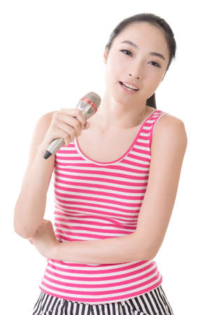 Asian girl take a microphone singing or speak, closeup portrait. photo