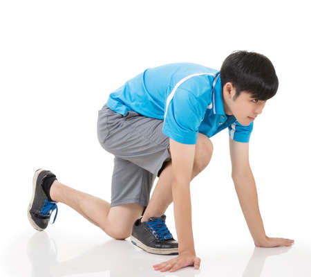 contender: Young Asian sportsman lined up getting ready for race. Stock Photo