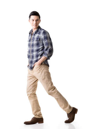 happy young man: Asian young man, full length portrait isolated on white.