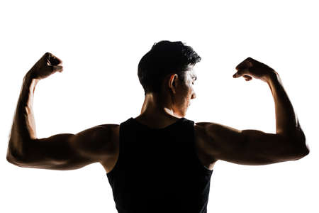 Rear view of healthy muscular young man with his arms stretched out isolated on white background. photo
