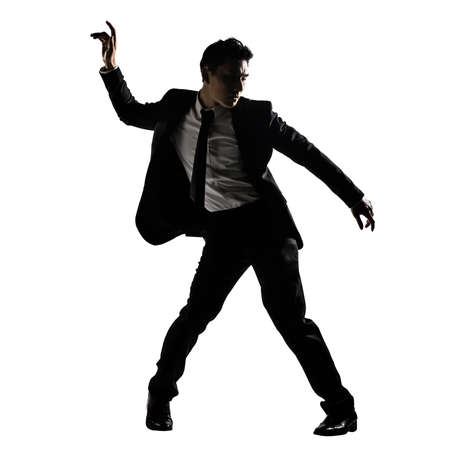 Silhouette of Asian businessman dancing or posing, isolated on white background. photo