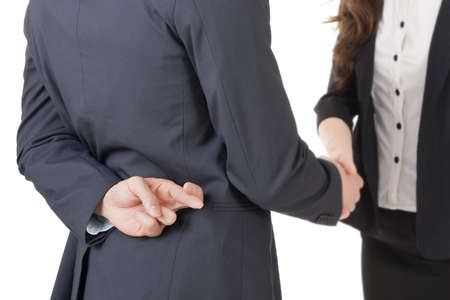 fake: Business woman and man shake hands and put finger cross on back, closeup portrait isolated on white background.