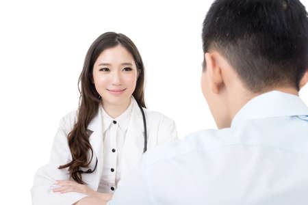 Asian doctor woman talking to a man in hospital office. Stock Photo - 27256620