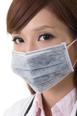 Asian doctor woman wear a surgical mask, closeup portrait. Stock Photo