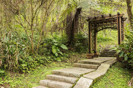 moon gate: Wooden gate door in the forest at Sun Moon Lake lakeside trail, Taiwan, Asia.