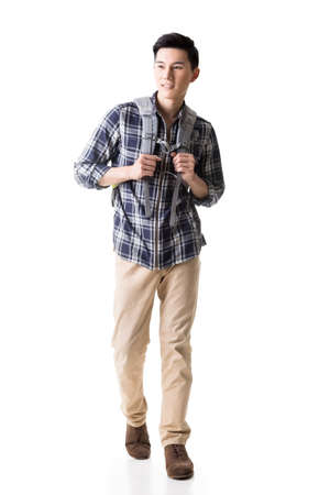 Asian young traveling man walking, full length portrait isolated on white.
