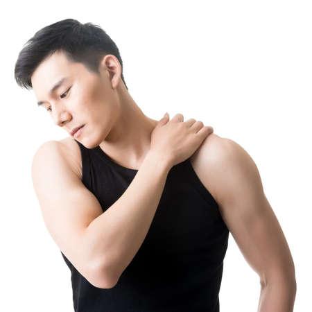 Asian young man having shoulder pain, closeup portrait on white. photo